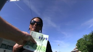 Sexy ebony babe Isabella trades sex for cash in a public park