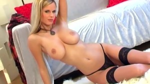 Glamour blonde lingerie tease in seamed stockings