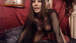 Hot brunette fishnet shirt and a strapon
