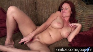 Busty redhead cougar waiting for your hard cock