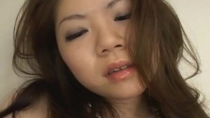 Japanese babe in a silver Bikini masturbates Uncensored