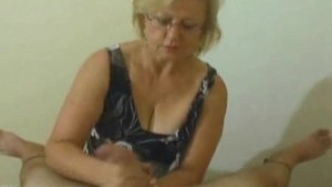 Mature babe playing with cocks
