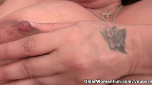 Granny with milk leaking nipple fucks a dildo