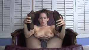 She gives you jerkoff encouragement with pantyhose covered feet