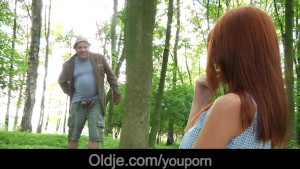 Old perv fucks a fiery redhead in the forest