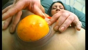 Mature fucks ass and cunt with fruits