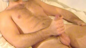 Handsome sport guy get wanked his huge cock in spite of him !