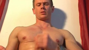 Gym trainer gets wanked his big cock by us!