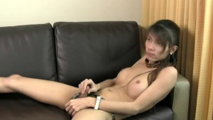 Asian brunette ladyboy jerks off and cumshots for the camera