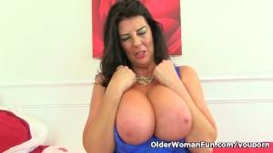 Busty and British milf Lulu Lush loves masturbating in fishnet tights