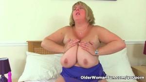 UK milf Melons Marie juggles her big tits and fucks a dildo