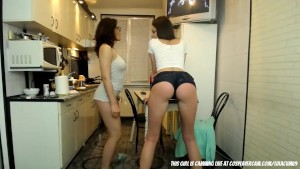Latina lesbians having fun in the kitchen