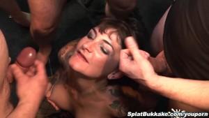 Ebony Lola Marie takes facials in a bukkake party