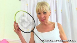 English gilf Elaine sticks a badminton racket up her pussy