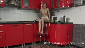Lavatta W strips naked and sexy in her kitchen