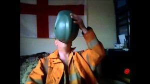 wanking in orange coverall and helmet, piss too