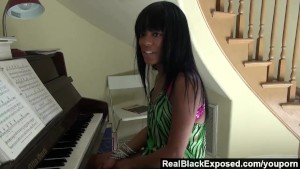 RealBlackExposed - Tila Flame shows off her tits and butt while playing piano.