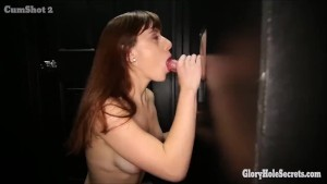 Two skinny brunettes sucking cocks in gloryhole