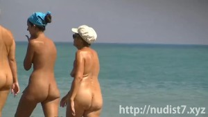 Sexy beach nudist women putting on lotion caught by spy cam