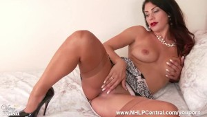 Brunette Roxy Mendez shows off sexy lingerie and juicy big tits as she spreads those shapely vintage nylon clad legs to toy pussy