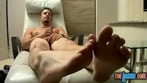 Mike Roberts plays with his feet before stroking his boner