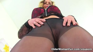 Pantyhosed milf Elegant Eve from the UK fucks a dildo