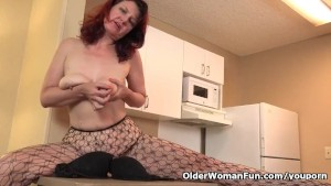 American milf Zoe puts her massager to work