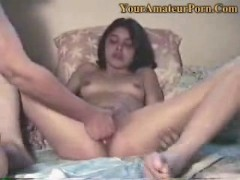 A guy is fingering his wifes wet pussy