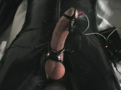 Electro stim in latex rubber with cumshot 1