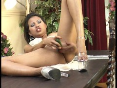 oriental girl plants a real cucumber