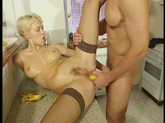 Maid gets frisky in the kitchen