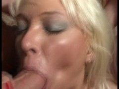 Blonde uses both hands to jack off two guys