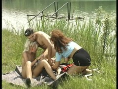 Tiny blonde and older redhead fuck young stud by the river.