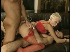 Short haired blonde hottie bounces on one cock while sucking another