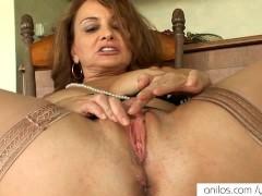 Hot mom slaps her mature pussy