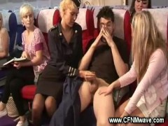 Plane babes raise trays for hot handjob with lucky guy