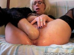 Perverted granny pushes her fist up h...