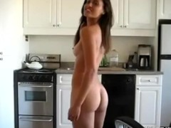 This college girl showing her great body in the kitchen