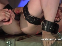 Blonde is bound in chains and fisted ...