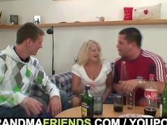 Blonde grandma swallows two big dicks