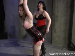 : Tattooed slave is whipped hard by her dominant mistress