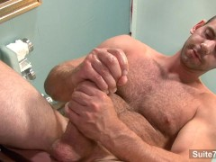 Horny gay doctor Girth Brooks masturbating in office