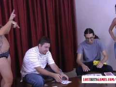 Two cute girls strip in front of their men during a card game