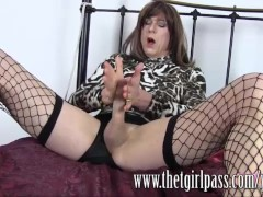 Slutty TGirl in fishnet stockings wanks big cock and finger fucks toys ass