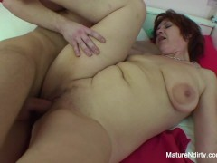 Mature brunette catches a young guy