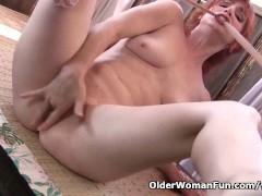 Redheaded milf Amber Dawn masturbates outdoors