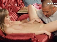 Defloration of Irina - a big guy seduces a blonde virgin