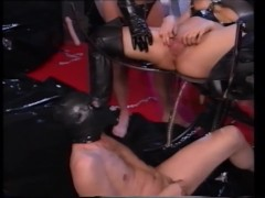 latex domina shows her slaves how to fuck her.mp4