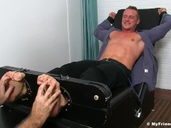 Kenny is tied up while wearing a business suit and tickled