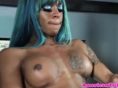 Ebony blue hair tgirl jerks cock after workout